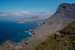 Coastline (8#X) Tags: ocean africa blue sky plants brown white mountain plant mountains tree green nature water grass grancanaria clouds spring spain outdoor afrika es canaryislands agaete nohdr 8x