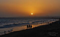 Hawksbay Beach, Karachi (Shehzaad Maroof Khan) Tags: pakistan sunset sea horse sun mountain reflection beach sand nikon peace play ride walk karachi sindh horseride hawksbay