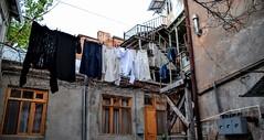 Hanging Laundry (Weekend Wayfarers) Tags: street travel urban streets travelling architecture georgia outside outdoors alley travels exploring travellers oldbuildings travellings clothes adventure explore laundry alleyway traveling streetscape oldbuilding travelers tbilisi travelblog streetscapes alleys alleyways tiflis travelphotography  travelphotographer travelblogs travelblogger travelings travelbloggers travelphotographers travelblogging weekendwayfarers
