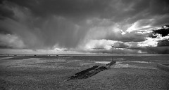 Passing rain, Thorpe Bay, Southend (Gordon Haws) Tags: pier estuary cumulus riverthames essex mudflats southend englishchannel isleofgrain tidalestuary fallingrain thamesestuary launchramp southendpier isleofgrainpowerstation isleofgrainpowerstationchimney