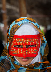 a bandari woman wearing a traditional mask called the burqa at panjshambe bazar thursday market, Hormozgan, Minab, Iran (Eric Lafforgue) Tags: red portrait people woman beauty vertical outdoors gold golden persian clothing eyes asia veil mask iran muslim islam religion hijab culture persia headshot hidden covered iranian bazaar adults adultsonly oneperson traditionaldress burqa customs ethnicity middleeastern frontview sunni burka chador 20sadult youngadultwoman balouch hormozgan onewomanonly lookingatcamera burqua  bandari  embroidering 1people  iro thursdaymarket  minab colourpicture  borqe panjshambebazar iran034i26762 boregheh