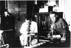 Researchers at the U.S. Public Health Service (National Institutes of Health (NIH)) Tags: laboratory phs microscope nih petridish bunsenburner researchers historicalphoto uspublichealthservice nihimagegallery