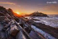 Faro de Tapia (Ivn F.) Tags: longexposure travel sea seascape tourism water rock marina landscape faro coast landscapes spain ngc asturias paisaje tapia ligthouse canoncanonistas6deos1635mmf4isl
