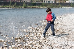 Kid throwing pebbles. (Giuseppe Pipia) Tags: street travel water rock stone youth canon river photography eos photo kid travels rocks foto child stones fiume streetphotography pebble pietre verona casual traveling splash fotografia acqua pietra canondslr viaggi viaggio throw bambino adige veneto travelphotography viaggiare giovane 70d canonphotography casuale canonphoto teamcanon