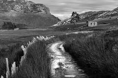 Cwmorthin Valley Ruins (kate willmer) Tags: blackandwhite bw mountains building monochrome grass rain wales fence landscape ruins path valley slate snowdonia cwmorthin slatemines blaunauffestinniog