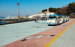 DSCF6356 (koribrus) Tags: ocean sea bus cars water harbor seaside fuji tour expo harbour korea pedestrians boardwalk fujifilm parked cart yeosu jeollanamdo x100s