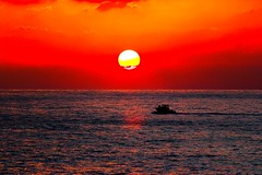 boat at sunset - Tel-Aviv beach (Lior. L) Tags: travel sunset sea sky orange sun reflection beach nature water silhouette canon reflections israel boat telaviv seascapes horizon tranquility telephoto orangesky redsky canondslr tranquil telephotolens canon70200f4l redsunset wonderfulnature orangesunset amazingnature awesomenature telavivbeach horizonbeach canon600d travelinisrael canont3i canonkiss5 boatatsunsettelavivbeach