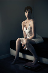 Jess (banegool) Tags: woman bedroom dress shorthair slip somber