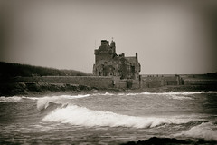 Ackergill Tower (SubSeaSniper) Tags: blackandwhite seascape castle monochrome landscape gothic wave canon100mmf2 gothictowers canoneos7d tintedmonochrome
