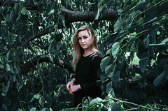 Kelly (2015) (Houston Roderick) Tags: black tree green nature girl hair cool dress wind blowing mysterious breeze
