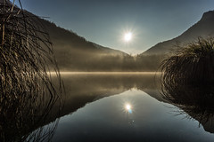Morning mist at the lake (SalvoSimon3) Tags: morning trees winter mist lake mountains water sunrise reflections lago glow alba riflessi watermirror