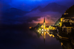 Early Dawn at Hallstatt (baddoguy) Tags: city morning blue sky mountain lake reflection nature water horizontal fog landscape outdoors photography dawn austria town smog twilight europe day cityscape village domination hill nopeople illuminated unescoworldheritagesite unesco backgrounds copyspace awe ancientcivilization oldtown thepast scenics centraleurope lowlighting salzkammergut unusualangle hallstatt upperaustria socialissues gmunden cloudsky traveldestinations colorimage famousplace beautyinnature igniting internationallandmark touristresort austrianculture europeanalps