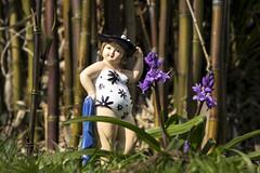 hattie in the bamboo garden (Mark Rigler UK) Tags: blue girl hat bells swim garden toy outside model fat towel bamboo size suit lass plus hattie