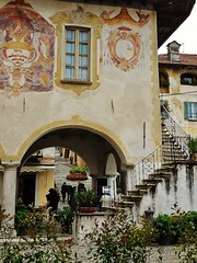 a corner of the townhall (SM Tham) Tags: italy plants building window architecture stairs facade square outdoors town mural market arches townhall balustrade wallpaintings lakeorta italianlakes ortasangiulio piazzamotta