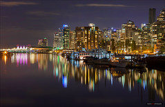 This Side Of Vancouver (Clayton Perry Photoworks) Tags: canada skyline night vancouver buildings reflections boats lights spring bc stanleypark canadaplace coalharbour explorebc explorecanada