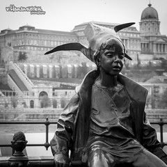 Kiskirlylny... Sitting by the Dandube promenade in Budapest (v.Haramustek) Tags: blackandwhite bw sculpture girl face statue fence blackwhite dock hungary noir child princess little magic ngc budapest prom promenade magical fortress kiskiralylany kiskirlylny budim dandube 1x1frame