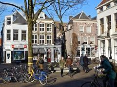 utrecht ganzenmarkt (gerben more) Tags: street city houses people woman man tree bike bicycle square town utrecht streetlife streetscene
