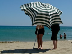 2 girls with a striped parasole (Colours of Pays Cathare) Tags: 2 france girls leucate striped parasole beach plage