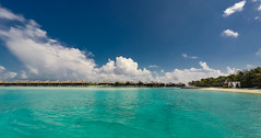 Water villas (Massimo Buccolieri) Tags: blue sea vacation sky seascape beach water clouds relax landscape island sand paradise bluesky palm resort tropical maldives atoll watervillas gop0001