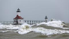 Surf is Up (khanusiak) Tags: ocean light sea lighthouse white lake storm water mi us marine waves unitedstates michigan caps stjoseph wave stormy lakemichigan waters saintjoseph southhaven whitecaps turbulent hanusiak