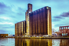 Canada Malting Silos (A Great Capture) Tags: street old blue sky urban brown lake toronto ontario canada reflection water reflections gold lights mirror downtown industrial photographer canadian quay silo harbourfront silos lakeontario bathurst on malting agc eireann jamesmitchell adjm eireannquay canadamaltingsilos wwwagreatcapturecom agreatcapture mobilejay