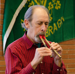 Carl Baron playing two tin whistles