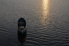 Lonely (kailas bhopi) Tags: morning sea sun reflection boat konkan malvan