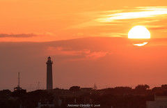 Last Natural Light (Antonio Ciriello) Tags: sunset italy sun lighthouse canon italia tramonto colours sole tamron 70 colori puglia taranto 70300 apulia sanvito fato 600d caposanvito 70300vc eos600d canoneos600d tamron70300vc rebelt3i 70300vcusd