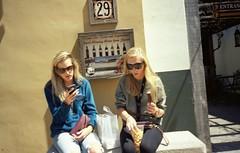 It's a sister thing. (zerotolerenc) Tags: 35mm florida strangers streetphotography hotgirls staugustine olympusxa blondegirls streetshooting kodakektar100