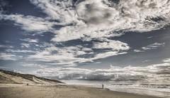 On est toujours tout seul au monde.... (Isabelle Gallay) Tags: ocean sea sky people mer beach nature clouds landscape landscapes alone fuji dune sable ciel fujifilm nuages paysage plage lacanau aquitaine gironde fujixm1 fujifilmxm1