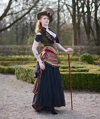 In The Gardens (Ben Gun) Tags: park woman hat female portraits 50mm ginger nikon dof dress f14 hamburg victorian redhead western steampunk edel rothaarig tiefenschrfe unschrfe viktorianisch d7100 ganzkrperportrait hutnoble