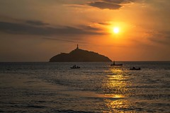 Colombian Coast (DavidAvila Photography) Tags: santa light sunset sky sun beach water skyline america landscape boats island photography coast nikon colombia shadows bright south shore marta fade borderline d3100