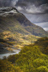 Snow in Spring (Vemsteroo) Tags: trees lake snow mountains colour castle industry nature beautiful wales clouds landscape spring slate llanberis snowdonia quarry unseasonal mountainscape northwales stormlight circularpolariser dolbadarn 40150mm llynperis