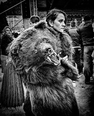 Lady with bear (Constantin Florea) Tags: life bear street city girls portrait people urban blackandwhite bw woman monochrome face lady canon blackwhite outdoor candid streetphotography romania streetphoto tradition capture moldova moldavia