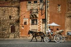 take a ride (aniretak) Tags: trip travel summer horse brown white umbrella buildings island coach europe mediterranean carriage south greece crete oldcity chariot chania