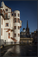 Esplanade Reflections (Donald Noble) Tags: light reflection building church stone architecture fence landscape scotland edinburgh flag historic spire boundary