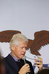 President Bill Clinton in Des Moines, Iowa (evan.guest) Tags: face bill wings chelsea eagle head clinton flag president political politics rally iowa presidential des hillary microphone moines caucus grasp caucuses