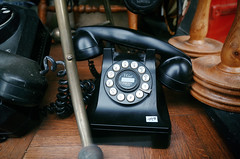 """""""Wait for dial tone"""" (Eric Flexyourhead (YVR catch-up mode!)) Tags: old city urban canada black detail window shop vancouver vintage store shiny bc phone display antique britishcolumbia telephone dial gastown ricohgr rotary fragment cordovastreet westcordova"""