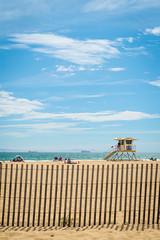 Beach Fence and Lifeguard Tower (sarahbethsmithphotography) Tags: beach vertical lifeguard sunsetbeach sunnybeach lifeguardtower picketfence beachscene californiabeach blueskybeach sarahbethsmithphotography