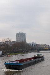 Air, Water, Land (HansPermana) Tags: city travel winter cold bus water river germany airplane deutschland ship cityscape cloudy frankfurt main transportation