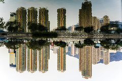 buildings in dance (Kai-Ming :-))) Tags: mountain reflection building tree water river hongkong estate sony tuenmun kaiming sonya7m2 tuenmunriver kmwhk