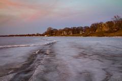 Frozen Lake Mendota (trevorklatko) Tags: park winter sunset urban orange lake texture ice nature wisconsin landscape madison mendota