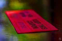 Red Ticket  2 (splinx1) Tags: blue red black blur macro reflection green focus bokeh ticket handheld boke minimalist hdr coupon oof superduper  photomatixpro redticket smcpm50f17  pentaxart gimp28 luckyticket 12rings