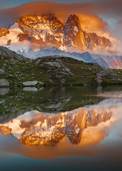 Les Drus Reflected at Sunset in Lac des Cheserey (Explored) (sunstormphotography.com) Tags: lake france mountains alps reflection reflections landscape alpine frenchalps chamonixvalley lesdrus polarisingfilter canon24105l montblancmassif ndgradfilter lacdescheserys valleedelarve canon5dmark3 larvevalley lacdechesery