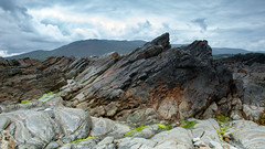 Born in Fire (RolandBrunnPhoto) Tags: ocean ireland sky plants mountains clouds landscape coast rocks meer europa europe pflanzen himmel wolken irland berge landschaft kste felsen nikond80