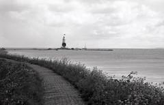Quiet still (Arne Kuilman) Tags: blackandwhite lighthouse film netherlands iso100 town nederland samsung scan apx100 pointandshoot v600 agfa vuurtoren marken stad 1839 hetpaardvanmarken slimzoom290ws