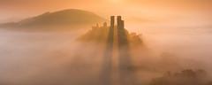 Corfe Castle sunrise (Jake Pike) Tags: light panorama mist colour sunrise landscape photography shadows jake dorset rays pike corfecastle purbecks