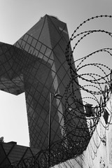 Canton Tower, Beijing with Barbed Wire (www.daevans.co.uk - Street Photography Workshops i) Tags: china blackandwhite wall tv beijing communication barbedwire cantontower