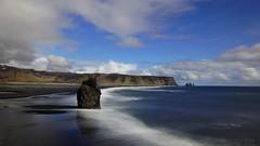 of sea monsters that turned to stone (lunaryuna (off to Iceland for 2 weeks)) Tags: sky panorama seascape weather clouds landscape coast iceland shoreline le shore lunaryuna atlanticocean blackbeach seastacks reynisfjara southiceland lightmood longexposurr