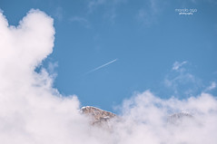 Higher than mountains (mariola aga) Tags: above blue winter sky italy white mountains closeup clouds airplane spring surreal saturation minimalism contrails higher hue dolomites thegalaxy